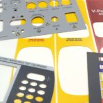 Screen-printed and steel-rule die cut polycarbonate panel overlays