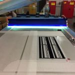 Behind the Screens: ultraviolet (UV) light is used to cure ink after custom screen printing