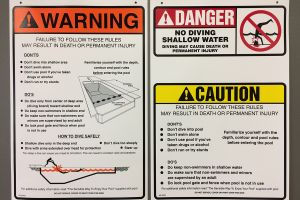 Custom danger placards screen-printed on polystyrene hold up to the harsh weather conditions