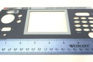 Screen-printed and die-cut polycarbonate overlay for instrument panel (showing tight registration)