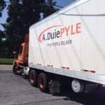 Screen-printed, thermal die-cut logo decals and custom die-cut lettering are shown after application to a fleet vehicle.