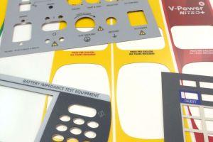 Screen-printed and steel-rule die cut polycarbonate panel overlays